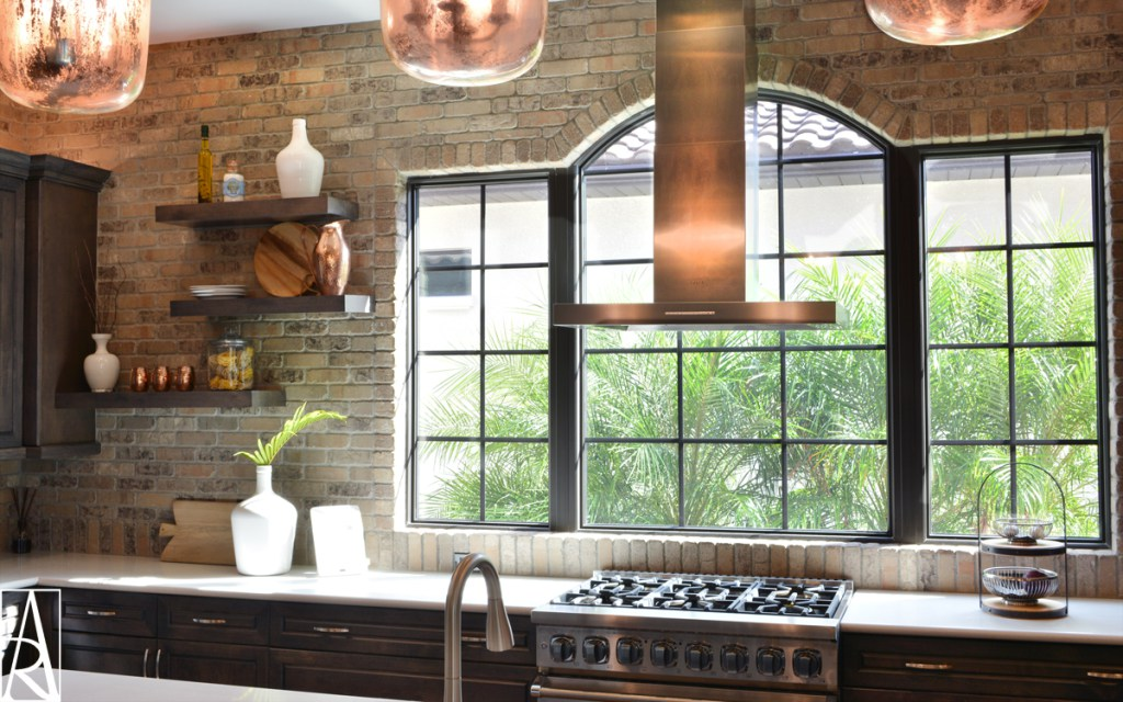 Styling of warm brick kitchen in Lakewood Ranch Florida interior designer Angela Rodriguez Interiors designing high end home interiors in The Lake Club, Country Club, Country Club East, The Concession.